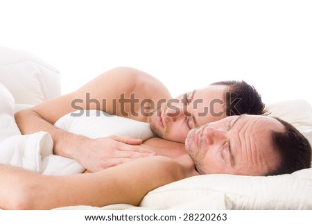 Happy couple in a white bed taking care of his boyfriend - stock photo