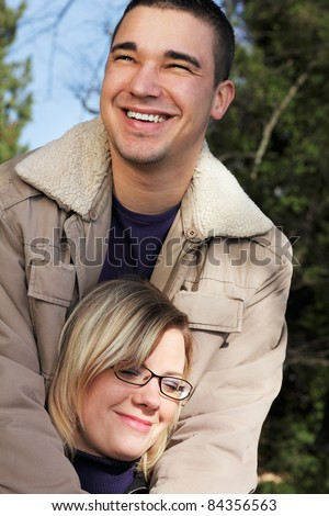 Happy couple in love, autumn outdoor shot of two young people. - stock photo
