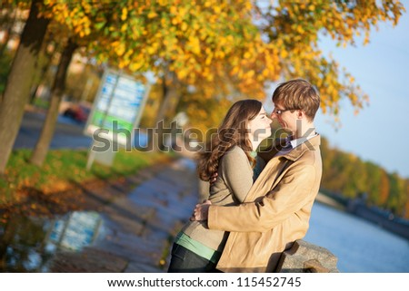 Happy couple in love hugging on the Fontanka embankment in Saint-Petersburg, Russia - stock photo