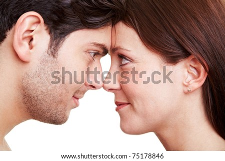 Happy couple in love looking deeply into each others eyes - stock photo