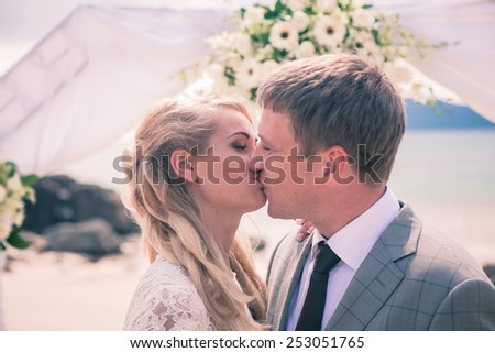 Happy Couple in love on wedding ceremony seaside tropical beach thailand phuket EUROPIAN STYLE arch