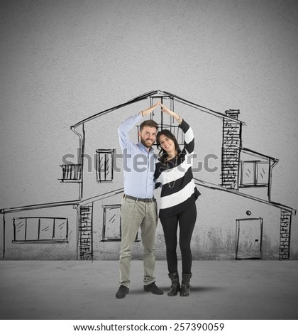 Happy couple in love planning a home - stock photo