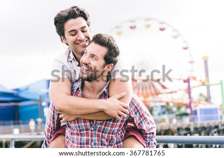 Happy couple in love playing in Santa monica on the beach. People and relationship concept - stock photo