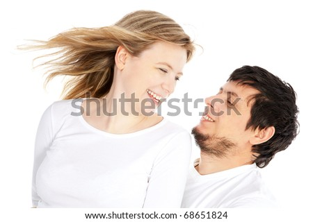 happy couple in love smiling over white background