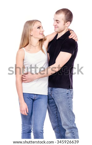 Happy couple in love. Studio photo on white background
