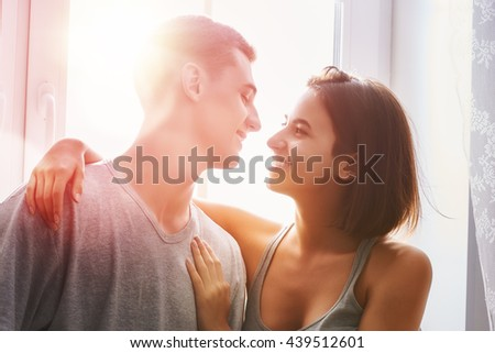 Happy couple in love. Stunning sensual portrait of young stylish fashion couple in bedroom.  - stock photo