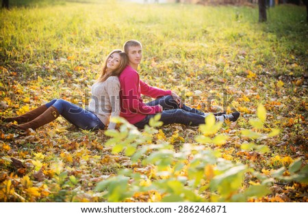 Happy couple in the autumn park - stock photo