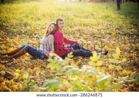 Happy couple in the autumn park - stock photo