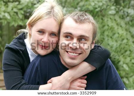 Happy couple in the garden - stock photo