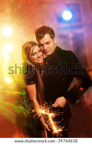 Happy couple in the night club - stock photo