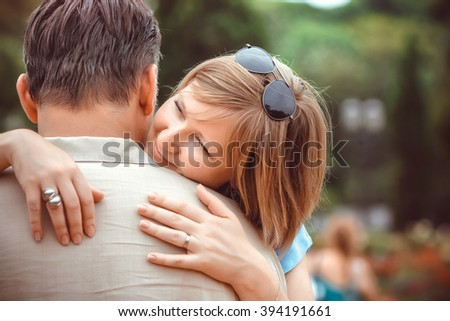 Happy couple in the park - stock photo