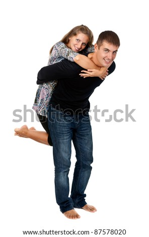 happy couple in the studio on a white background
