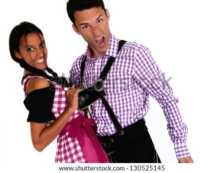 Happy couple in traditional Bavarian clothes posing on white background