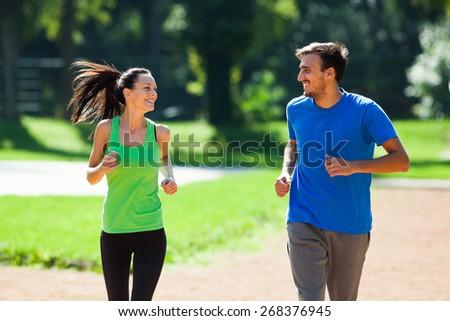 Happy couple jogging - stock photo