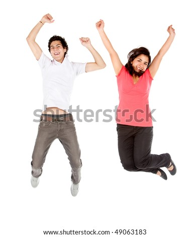 Happy couple jumping isolated over a white background