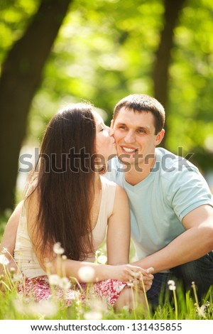 happy couple kissing in the park