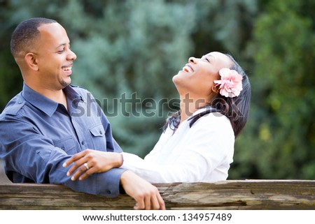 Happy couple laughing - stock photo