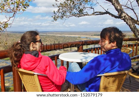 Happy couple looking at beautiful view of Kruger national park, travel  and safari in South Africa  - stock photo