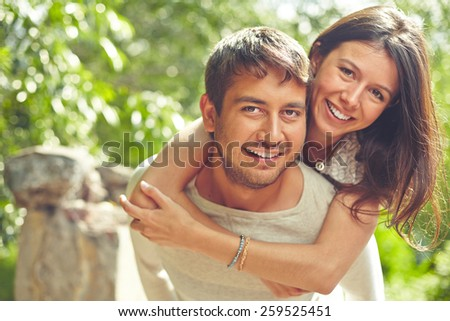 Happy couple looking at camera and smiling - stock photo