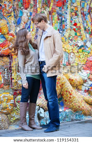 Happy couple looking to each other and smiling - stock photo