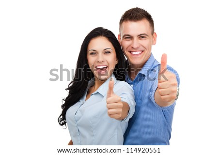 happy couple love excited smiling holding thumb up gesture, beautiful young man and woman smile looking at camera, isolated over white background - stock photo