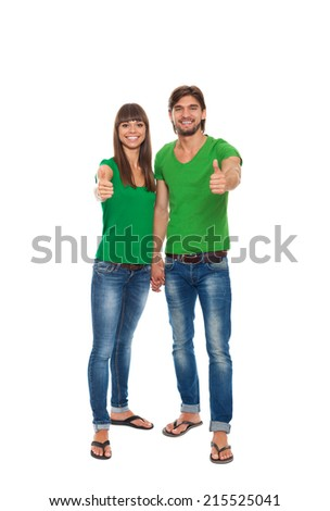 happy couple love excited smiling holding thumb up gesture, beautiful young man and woman smile looking at camera, wear green t shirt isolated over white background