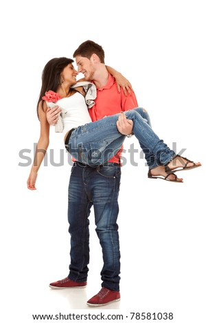 happy couple -  man  carrying girlfriend in his arms over white - stock photo