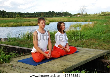 Happy couple meditating together