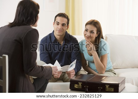 Happy Couple Meeting with Real Estate Agent - stock photo