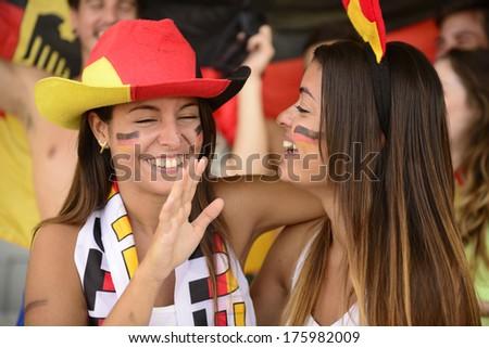 Happy couple of girlfriends sport soccer fans celebrating. - stock photo