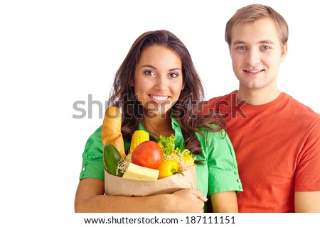 Happy couple of healthy eating followers looking at camera - stock photo