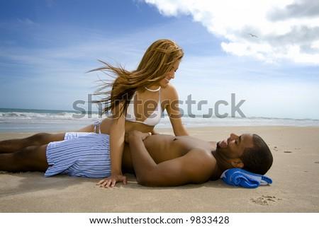 Happy couple on a beach - stock photo