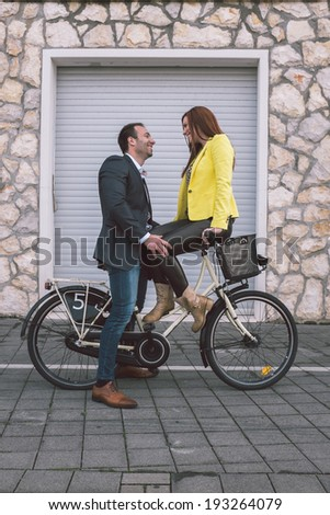 Happy couple on a bike - stock photo