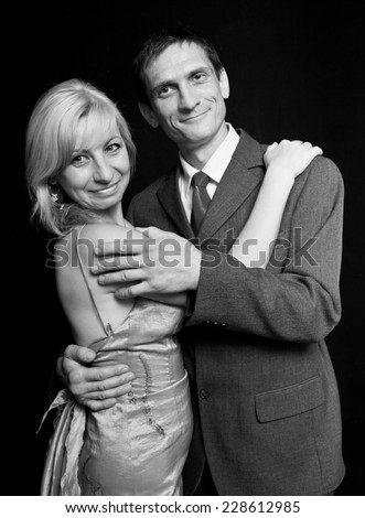 happy couple on a black background.man and woman.family holiday.Black-and-white image. - stock photo