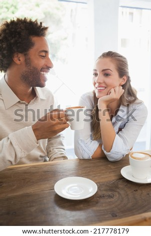 Happy couple on a date having coffee at the coffee shop - stock photo