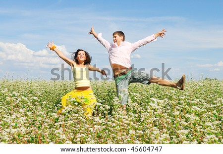Happy couple on a lawn