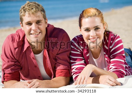 happy couple on beach - stock photo