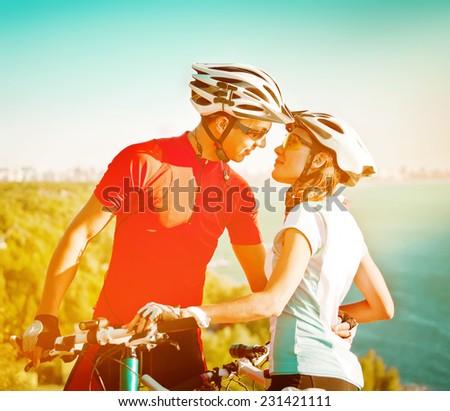 happy couple on bicycles - stock photo