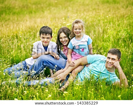 Happy couple on green grass.Outdoor.