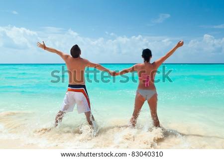 Happy couple on holidays at Caribbean Sea - stock photo
