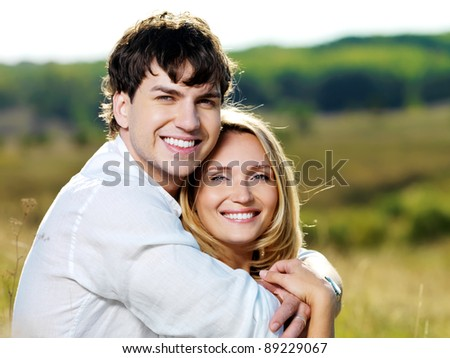 Happy couple on nature - stock photo