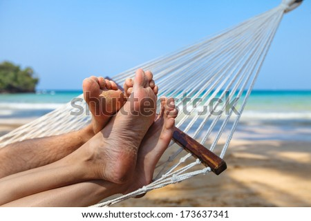happy couple on the beach in honeymoon - stock photo