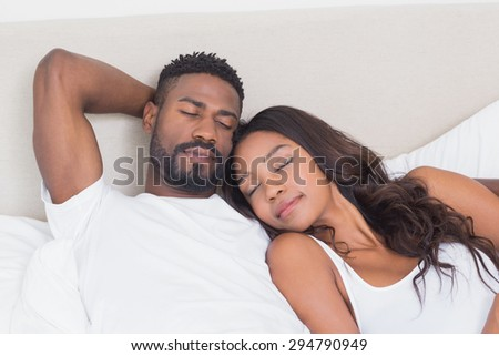 Happy couple on the bed sleeping at home in bedroom - stock photo