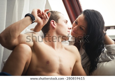 Happy couple on the couch in the morning  - stock photo
