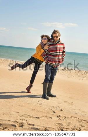 happy couple on the seashore - stock photo