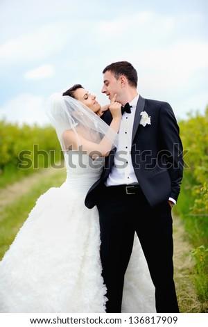 Happy couple on wedding day, summertime - stock photo