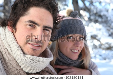 Happy couple on winter walk - stock photo