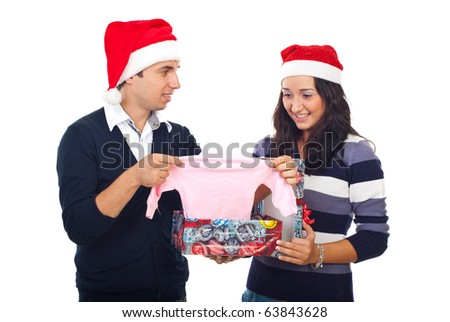 Happy couple  open a gift and receiving surprising news at Christmas by  found a baby cloth in box,they will be parents
