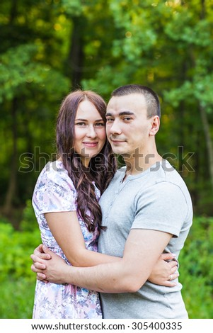 Happy Couple Outdoor. Smiling Couple Relaxing in a Park.   - stock photo