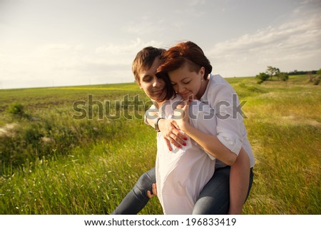 Happy couple outdoor, summertime - stock photo
